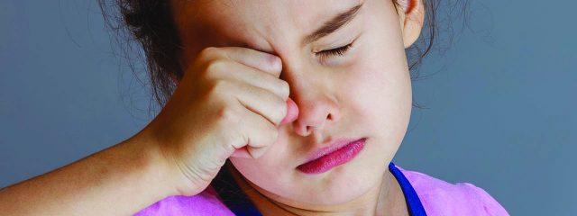 Eye doctor, asian girl rubbing eyes in Jacksonville, Florida