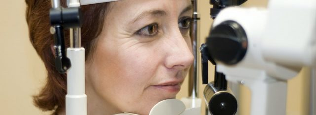Optometrist, woman at a contact lens eye exam in Jacksonville, Florida