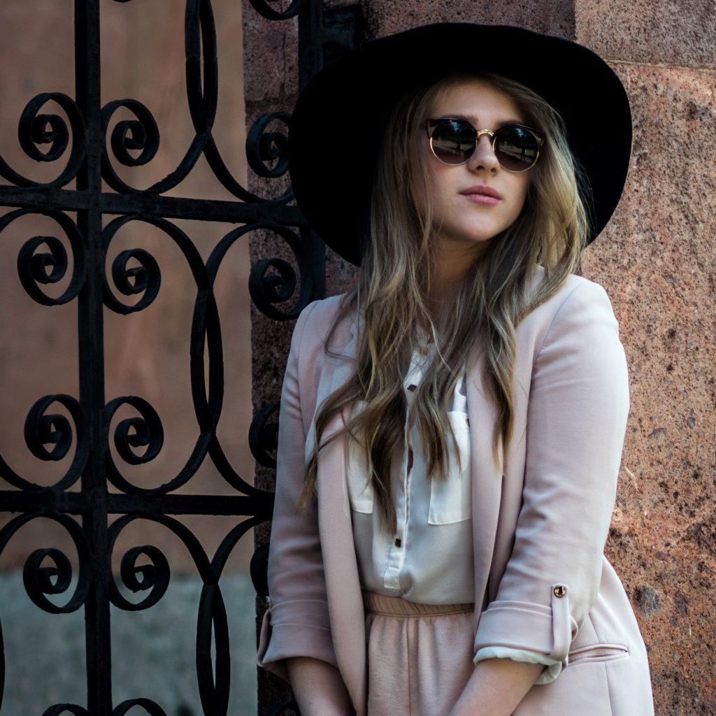 woman sunglasses hat wall