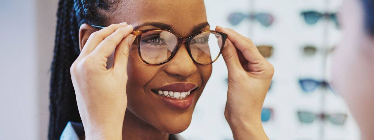 Eye care, woman buying eyeglasses with insurance in Sandpoint, ID