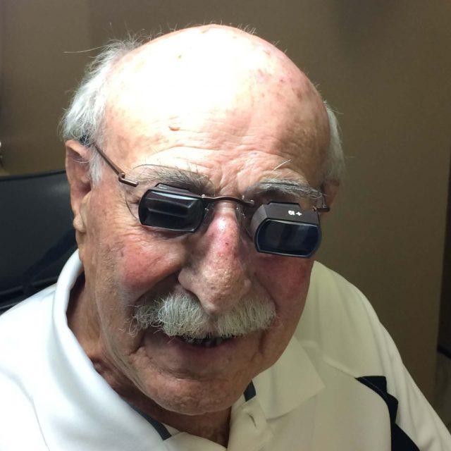 senior man wearing low vision glasses
