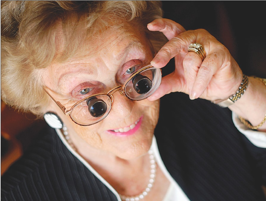 senior woman with macular degeneration, using bioptic telescopes