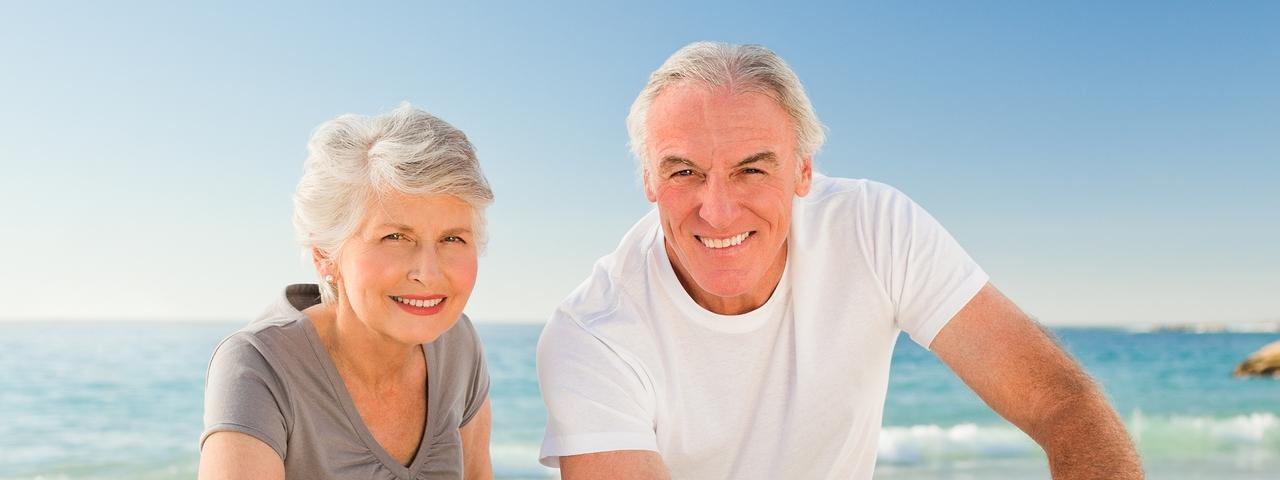 senior couple by beach