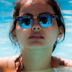 Eye doctor, girl wearing sunglasses in the pool in North Miami Beach, FL