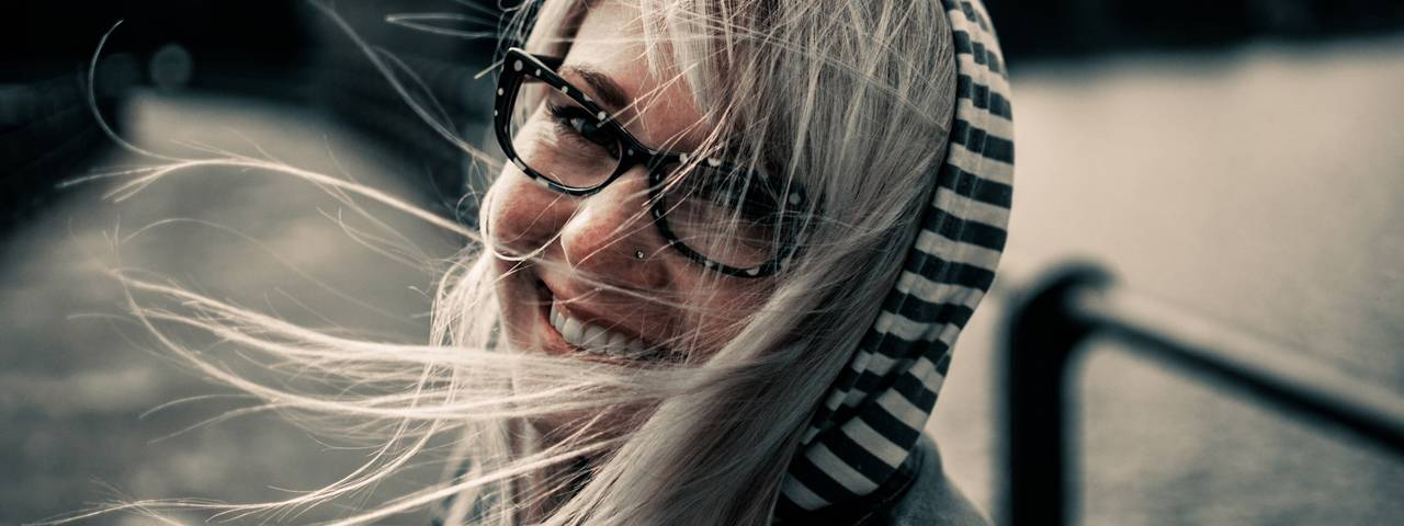 Eye doctor, woman wearing eyeglasses in North Miami Beach, FL