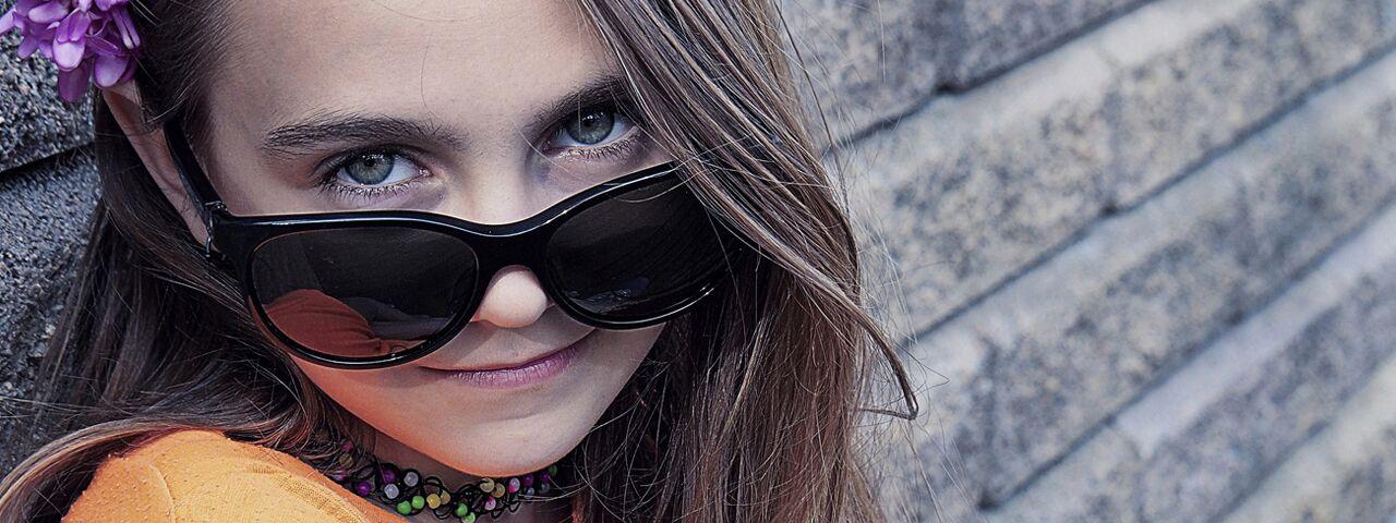 Eye doctor, girl wearing sunglasses in North Miami Beach, FL