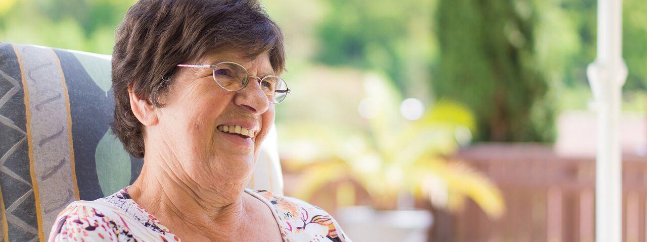 Eye doctor, senior woman smiling in North Miami Beach, FL