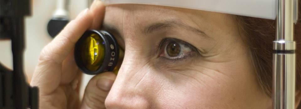 Eye doctor, woman at a diabetic eye exam in North Miami Beach, Florida