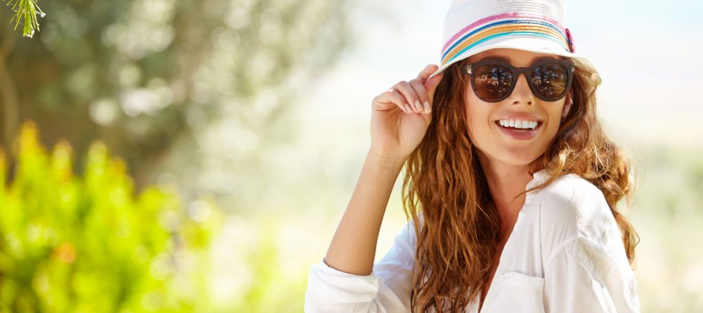 Woman in Hat and Sunglasses