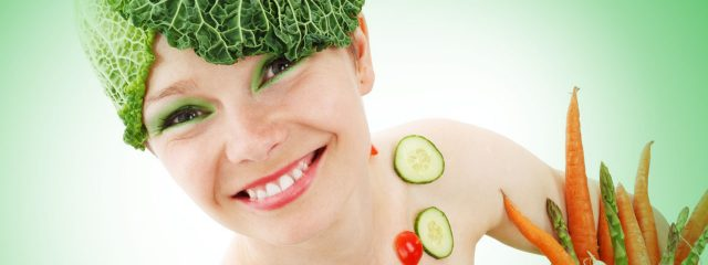 Optometrist, smiling woman covered in vegetables in Fort Collins, CO