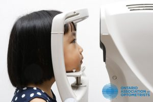 Children's eye exam, little asian girl getting her eyes checked in Unionville, ON