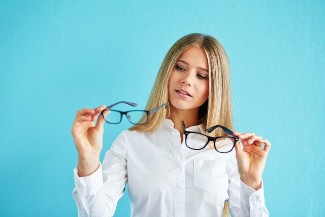 Pensive woman with glasses