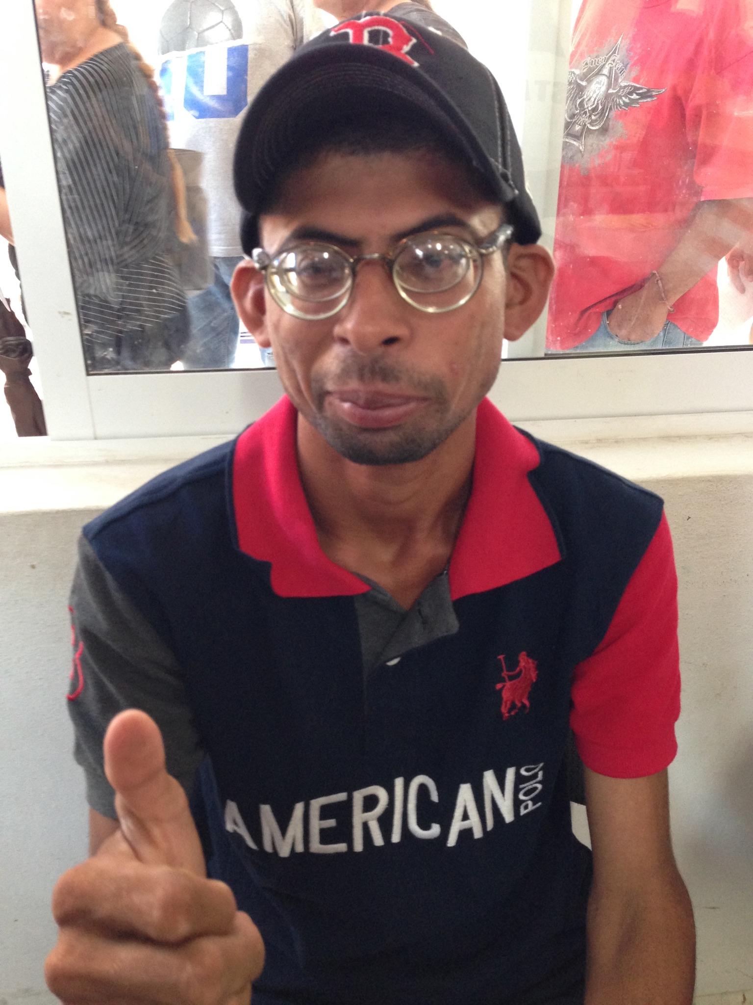 Man in cap and glasses
