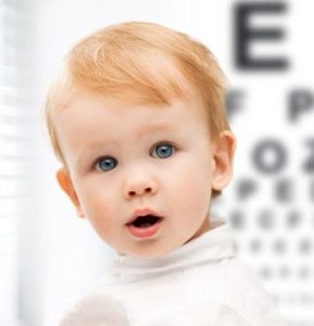 child in eye exam