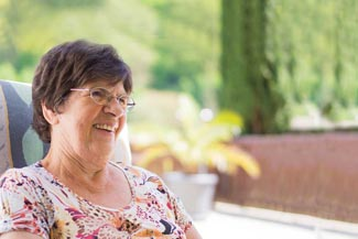 grandmother sitting and laughing with glasses.jpg