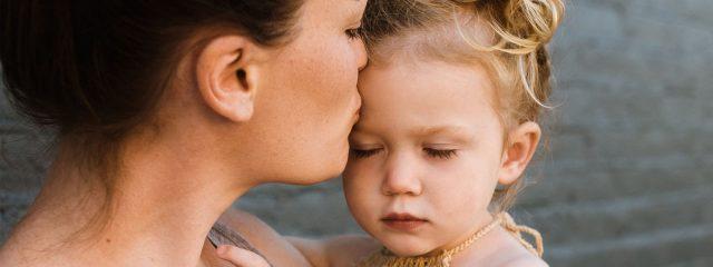 optometrist, mom kissing her daughter in Cedar Park, TX