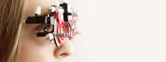Optometrist, woman at a contact lens eye exam in Holt, MI