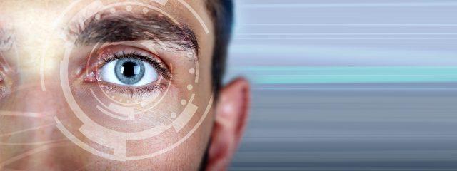 Optometrist, man, LASIK digital eye exam in Holt, MI