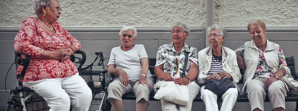 Senior woman sitting together on a bench