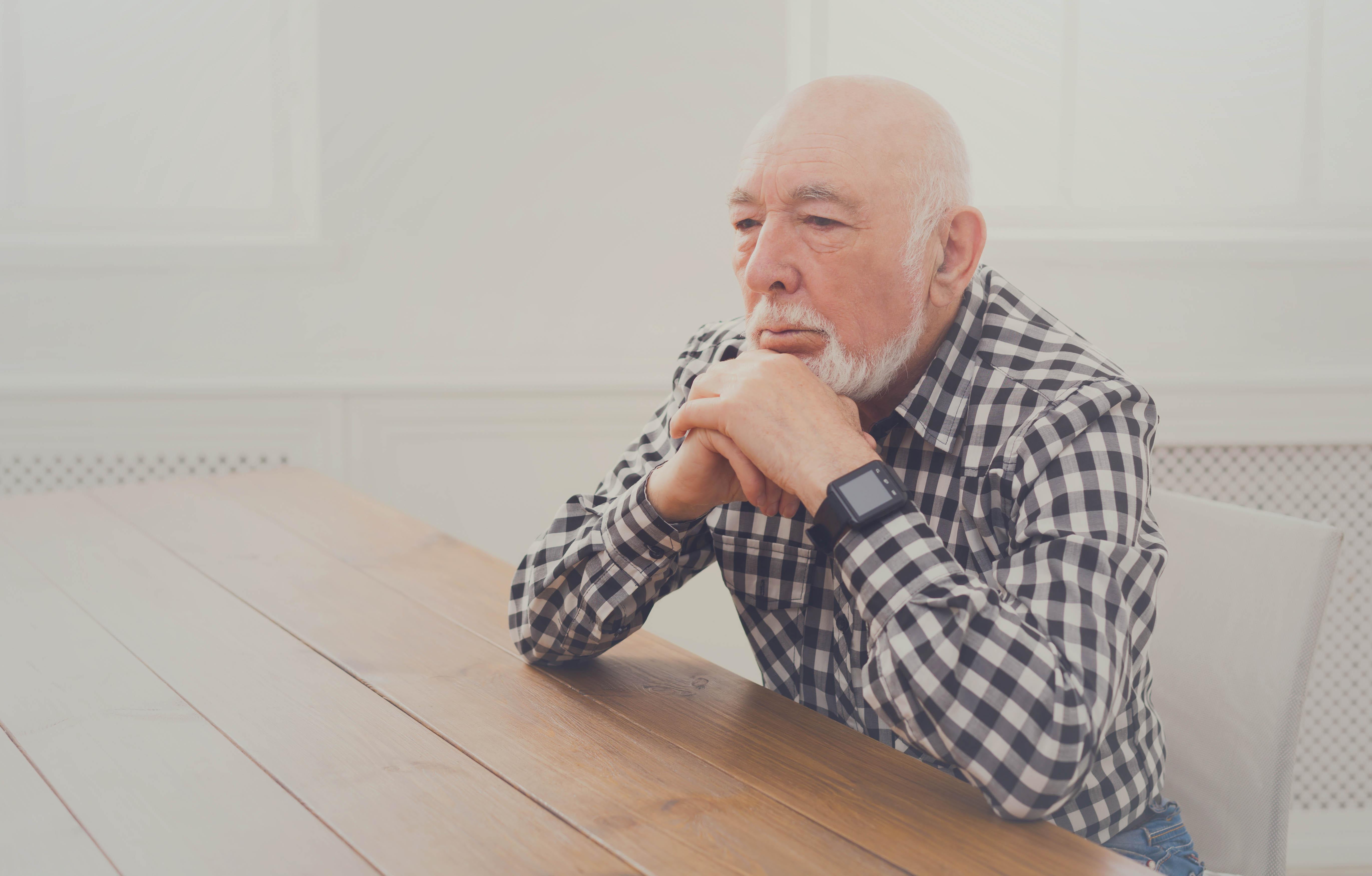 eye exam, Senior Man Thinking at Table in St Albert, AB