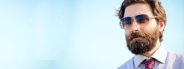 Eye doctor, bearded man wearing sunglasses in Clive, Iowa
