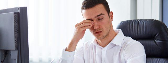 Eye doctor, man rubbing his eyes in Clive, Iowa