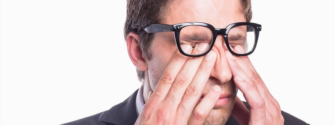 Eye exam, man rubbing his eyes in Clive, IA