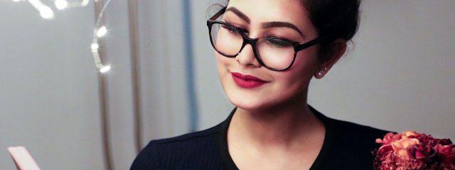 Eye doctor, woman wearing reading eyeglasses in Toronto, ON