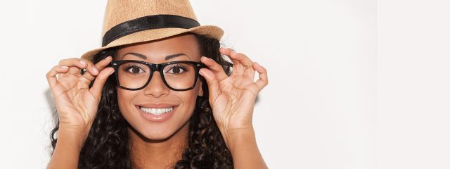 Optometrist, woman wearing designer eyeglasses in Toronto, ON