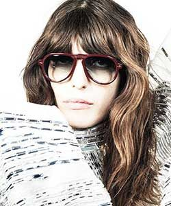 Jacques Marie Mage woman burgandy glasses white background 1061x733px