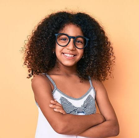 African american child with curly hair wearing casual clothes an