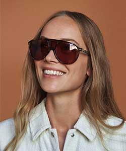 Model wearing Persol sunglasses