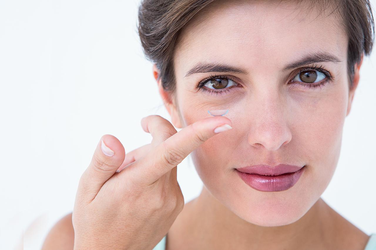 Eye exam, woman wearing contact lenses in Kamloops, BC