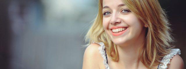 Woman Smiling 1280x480 640x240