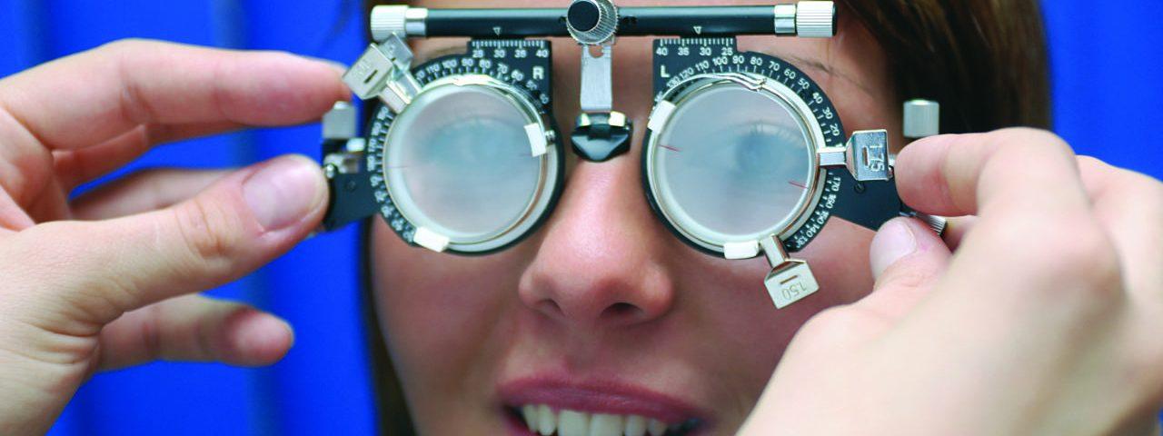 Optometrist, woman receiving contact lens exam in Kamloops, BC