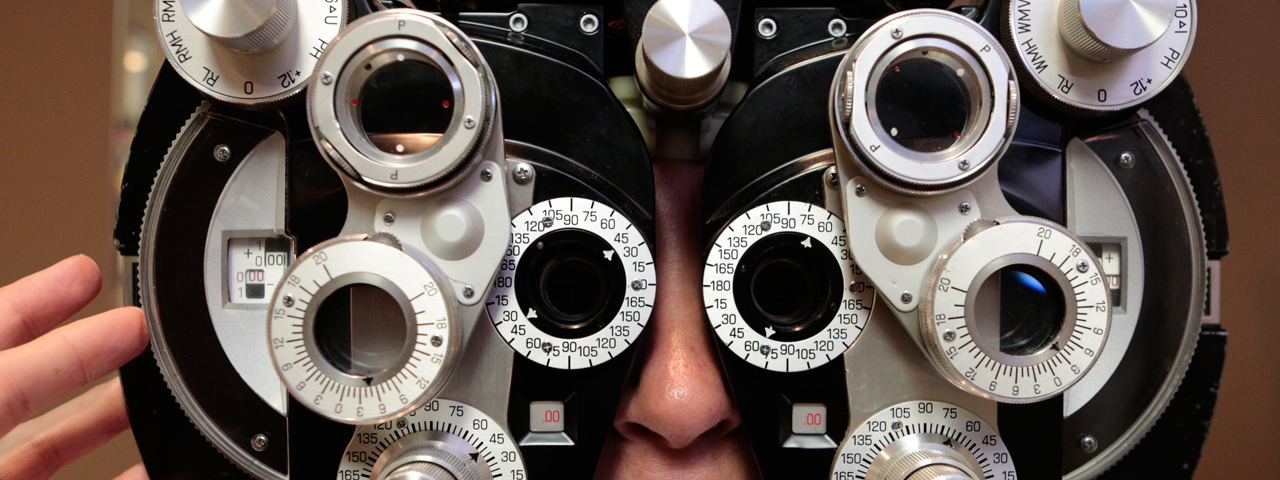 Optometrist, doctor examining woman for contact lenses in Kamloops, BC