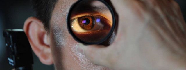 Eye exam, man receiving eye exam for red eye emergency in Kamloops, BC