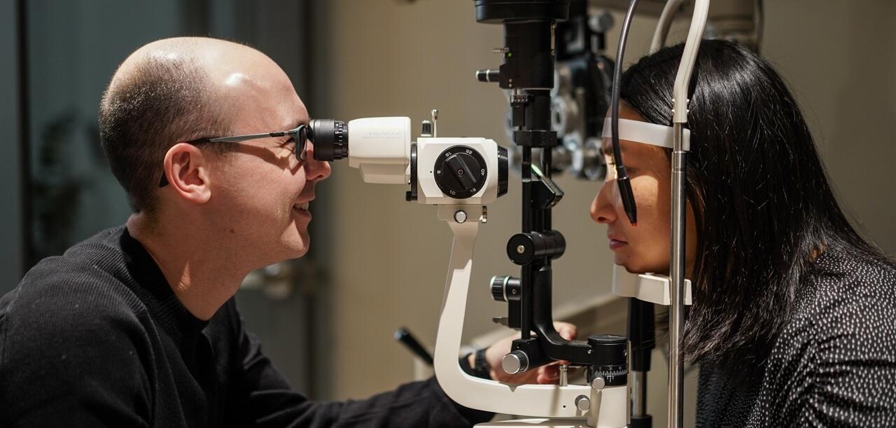 Optometrist, man receiving eye exam in Kamloops, BC