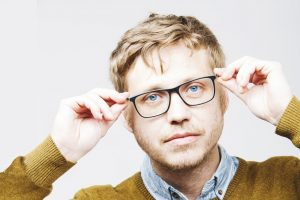 Man trying on a pair of eyeglasses