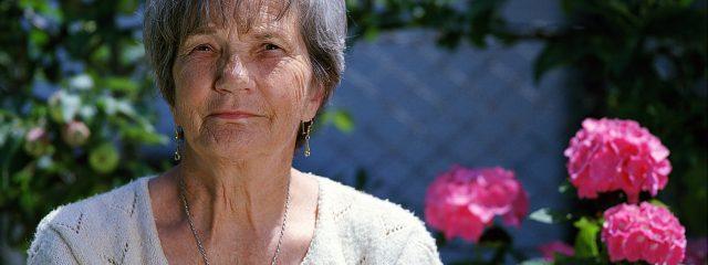 Eye doctor, senior woman with flowers in Saint Petersburg, FL