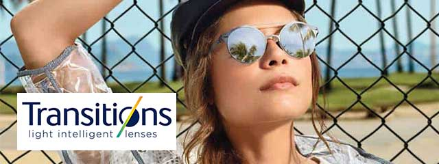 Optometrist, woman wearing transitions eyeglasses in Saint Petersburg FL