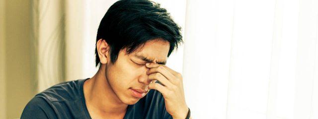 Optometrist, asian man suffering from sore eyess in Jacksonville, FL