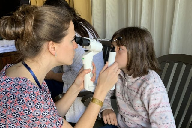 Optometrist, litle girl is receiving eye exam in New Holland, Pennsylvania