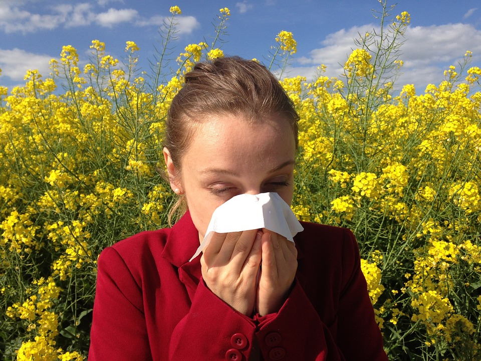 Girl with allergies sneezing in a field - Colorado Springs, CO
