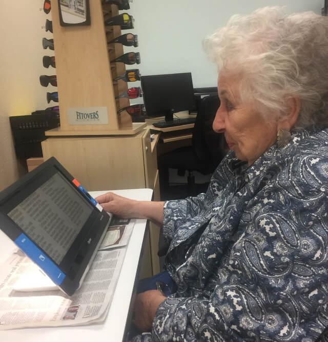 senior woman using traveller hd device