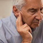 Side view of senior man with symptom of stroke