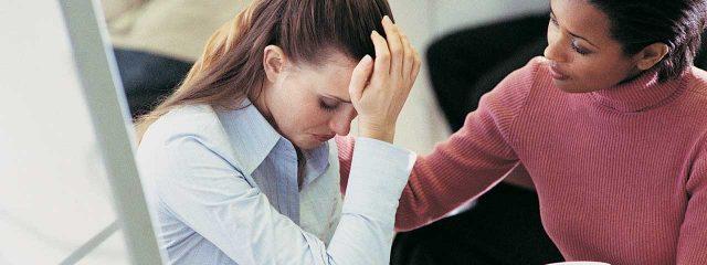 Woman comforting depressed girl