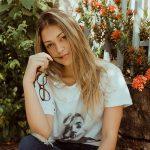 girl holding glasses garden 640