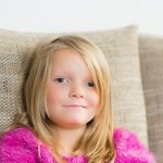 little girl with myopia