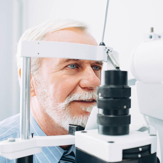Senior Patient Receiving Eye Exam At Clinic, Eyesight Examinatio
